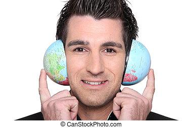Man using the world as headphones