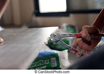 Man using tile cutting tool