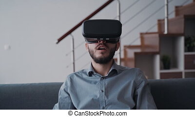 Man using virtual glasses and spending free time at home -...