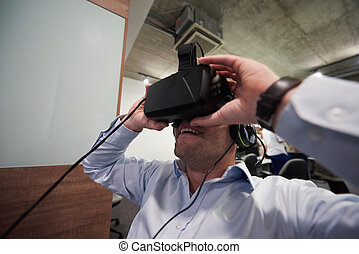 man using virtual reality gadget computer glasses - young...