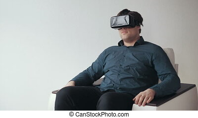 Man Using Virtual Reality Glasses. Special Headset. Isolated on White Bckground