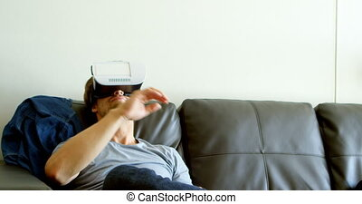 Man using virtual reality headset in living room 4k