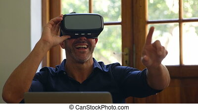 Man using virtual reality headset in office 4k