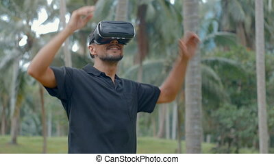 Man using virtual reality headset in the jungle