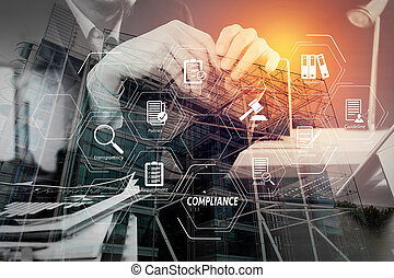 Compliance Virtual Diagram for regulations, law, standards, requirements and audit. Man using VOIP headset with digital tablet computer as concept communication or it support or call center and customer service.
