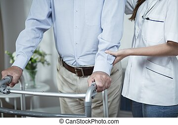 Man using walking frame