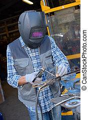 Man using welder