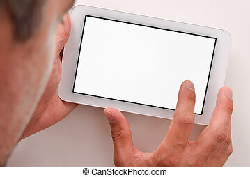 Man using white tablet with white screen on wood table