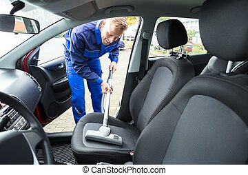 Man Vacuuming Car Seat