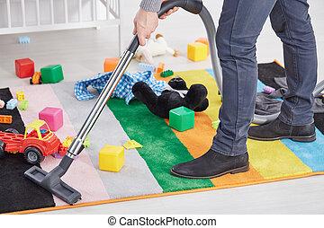 Man vacuuming child's room