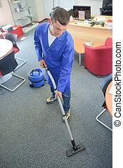 Man vacuuming office