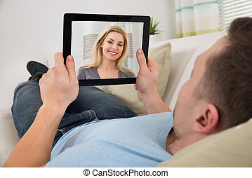 Man Video Chatting With Woman On Digital Tablet