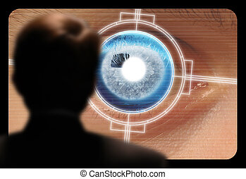 Man viewing a retinal eye scan on a video monitor