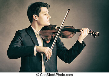 Male violinist playing classical music on violin  fiddler