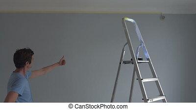 Man visualising something on the wall