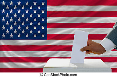 man voting on elections in america in front of flag