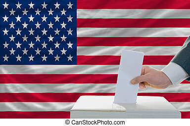 man voting on elections in america - man putting ballot in a...