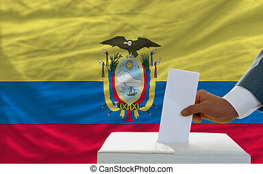 man voting on elections in ecuador in front of flag