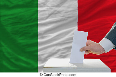 man voting on elections in italy in front of flag - man...