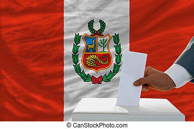 man voting on elections in peru in front of flag
