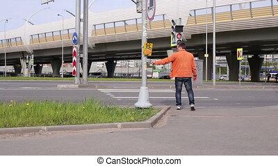 Man Waiting For Green Light