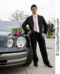 Man waiting for his date - Attractive man stands next to a ...