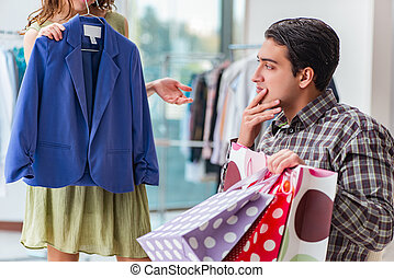 Man waiting for his wife during christmas shopping