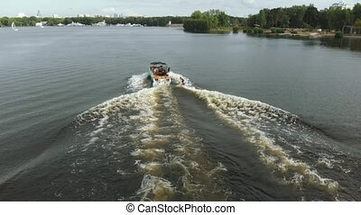 Man wakeboarding on river waves after a boat. Rider going...