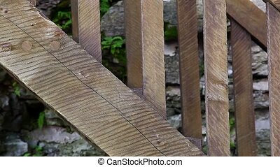 wooden staircase - Man walk down a wooden staircase