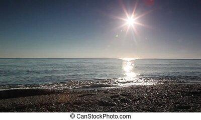 Man walk in seawater along waterline