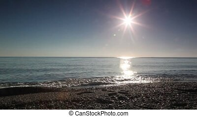 Man walk in seawater along waterline