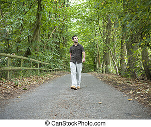Man walking along a country lane