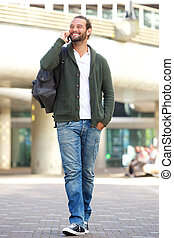 Man walking and talking on mobile phone in the city