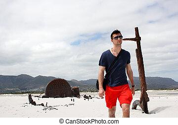 Man walking at Shipwreck Kakapo at the beach of kommetjie