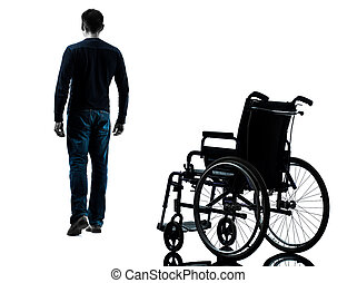 man walking away from wheelchair silhouette