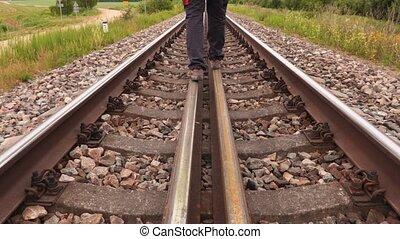 Man walking away on railway