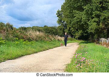 Man walking dog in nature