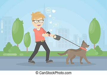 Man walking dog. Smiling boy chatting with smartphone in the park.