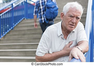 Man walking down stairs - Senior weak man is walking down...