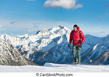 Man walking in a winter landscape whit snowshoes