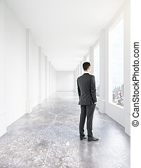 Man walking in corridor interior