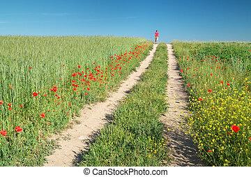 Man walking in green meadow