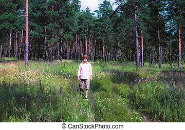 Man Walking in Pine Forest