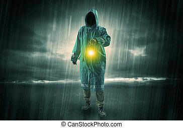 Man walking in storm with lantern