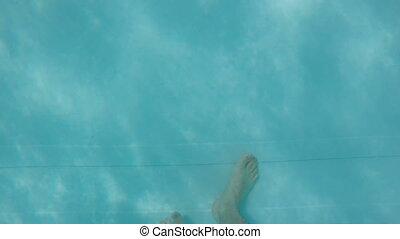 Man walking in swimming pool