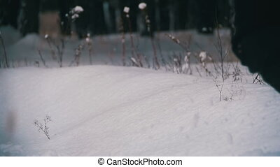 Man Walking in the Deep Snow in the Winter Forest at Snowy...
