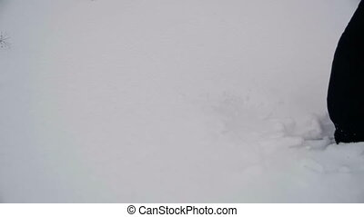 Man Walking in the Deep Snow. Slow Motion