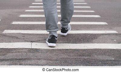 Man walking on a zebra - City street zebra crossing with one...
