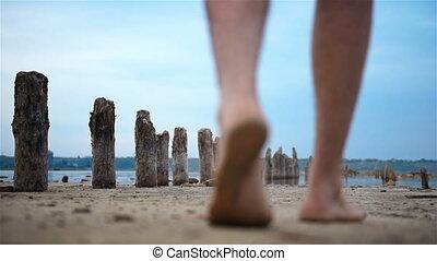 Man Walking On Abandoned Beach