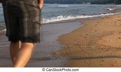 Man walking on beach  of the Baikal